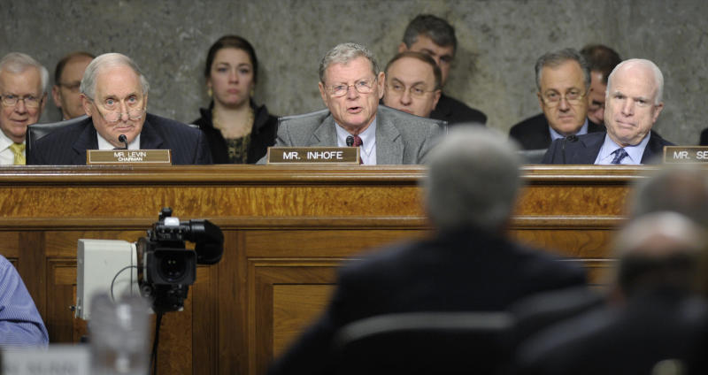 Senate Armed Services Committee ranking member Sen. James Inhofe, R-Okla., second from left, asks a question of former Nebraska Sen. Chuck Hagel, second from right, President Barack Obama's choice for defense secretary, on Capitol Hill in Washington, Thursday, Jan. 31, 2013, during the Senate Armed Services Committee hearing on his nomination. Senate Armed Services Committee Chairman Carl Levin, D-Mich., left, and Sen. John McCain, R-Ariz., right, listen. (AP Photo/Susan Walsh)
