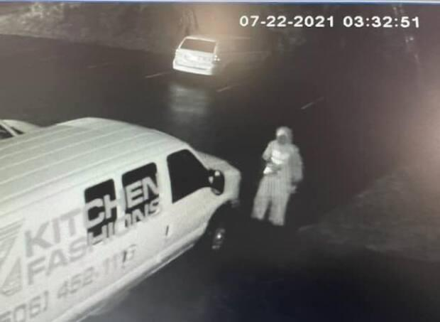 At around 3 a.m. Thursday morning, a man is spotted on security footage smashing the windows of three vans.  (Submitted by Home Fashions  - image credit)