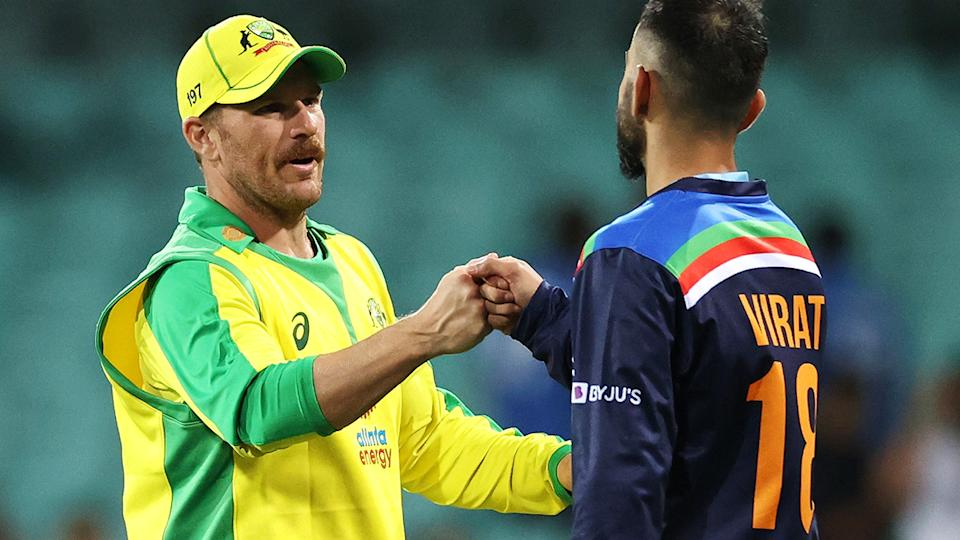 Aaron Finch and Virat Kohli, pictured here after the second ODI between Australia and India at the SCG.