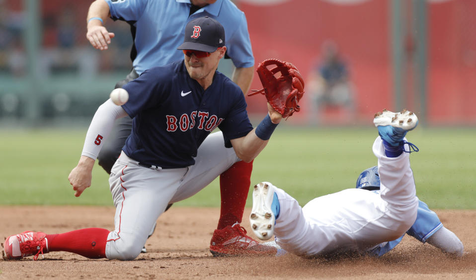 Boston Red Sox second baseman Enrique Hernandez, left, catches a late throw as Kansas City Royals' Whit Merrifield, right, steals second base in the first inning of a baseball game at Kauffman Stadium in Kansas City, Mo., Saturday, June 19, 2021. (AP Photo/Colin E. Braley)