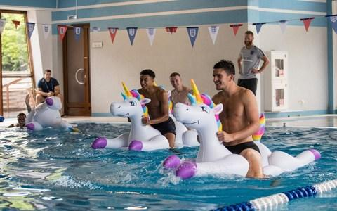 Kieran Trippier, Jordan Pickford, Jesse Lingard and Harry Maguire play with inflatable unicorns - Credit: Eddie Keogh for FA/REX/Shutterstock