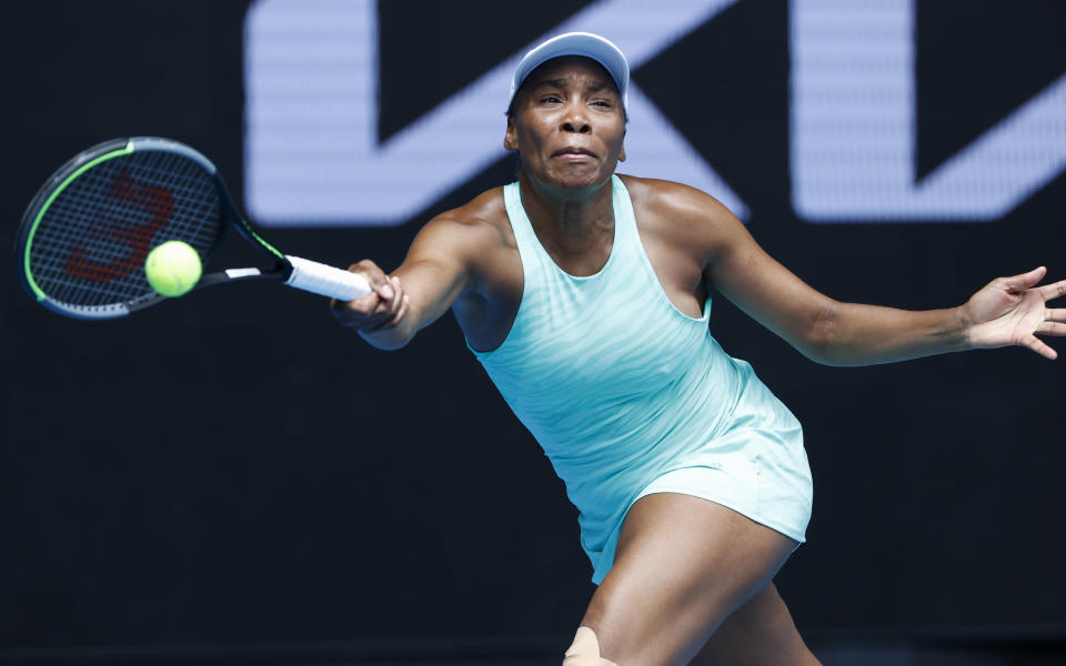 United States' Venus Williams makes a forehand return to Belgium's Kirsten Flipkens during their first round match at the Australian Open tennis championship in Melbourne, Australia, Monday, Feb. 8, 2021.(AP Photo/Rick Rycroft)