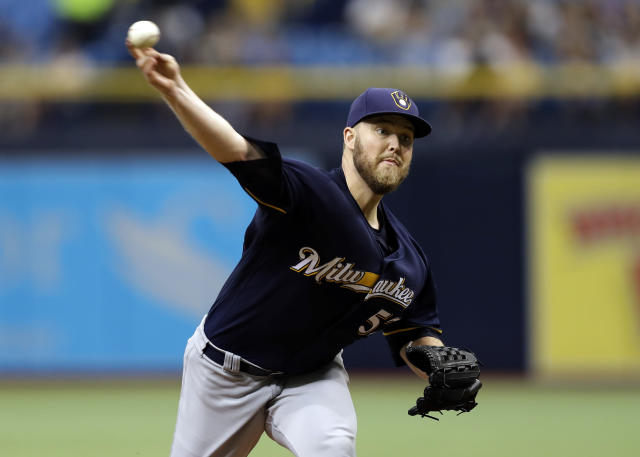 FILE - In this Sunday, Aug. 6, 2017 file photo, Milwaukee Brewers' Jimmy Nelson pitches to the Tampa Bay Rays during the first inning of an interleague baseball game in St. Petersburg, Fla. Milwaukee Brewers right-hander Jimmy Nelson is bracing himself for an emotional return Wednesday, June 5, 2019 against the Miami Marlins. Nelson hasnt pitched in a major league game since he injured his pitching shoulder diving back to first after rounding the base on a single in September 2017. (AP Photo/Chris O'Meara, File)