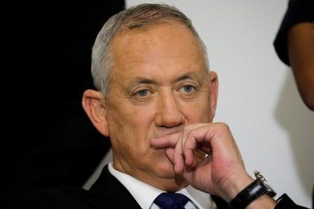 Benny Gantz, leader of Blue and White, looks on after delivering a statement before his party faction meeting in Tel Aviv, Israel