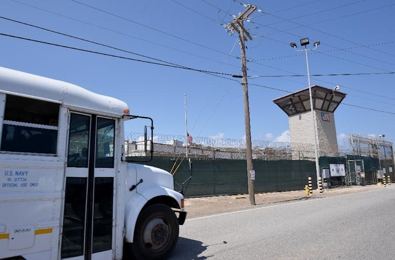 "This photo made during an escorted visit and reviewed by the US military shows the razor wire-topped fence and the watch tower of ""Camp 6"" detention facility at the US Naval Station in Guantanamo Bay, Cuba, on April 8, 2014 (AFP Photo/Mladen Antonov)"