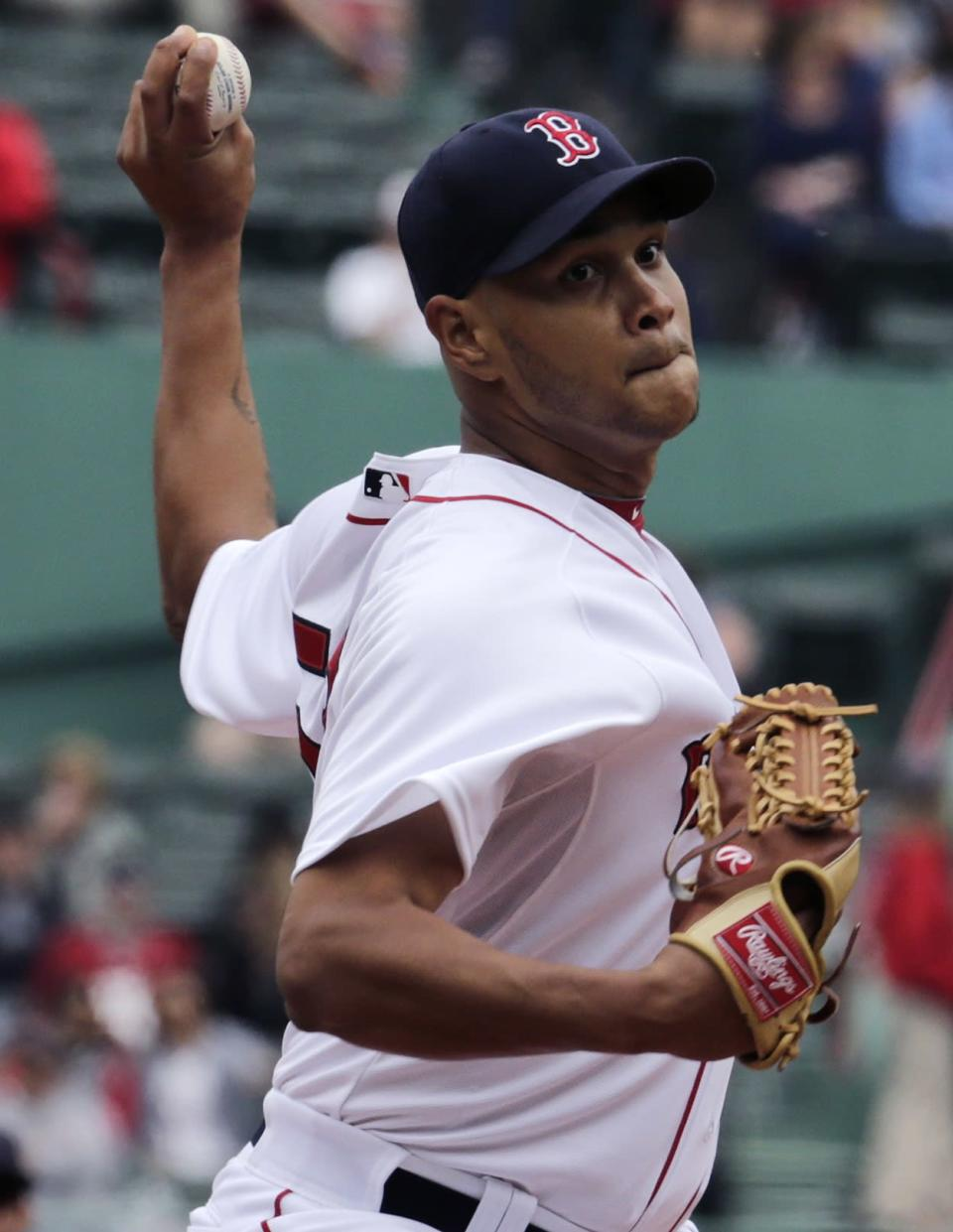 Boston Red Sox starting pitcher Eduardo Rodriguez delivers against the Minnesota Twins during the first inning in the first baseball game of a doubleheader at Fenway Park in Boston, Wednesday, June 3, 2015. (AP Photo/Charles Krupa)