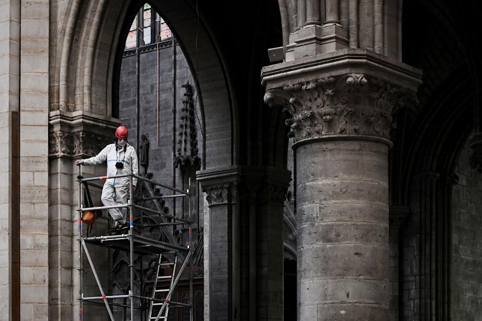 A worker stands on scaffolding during preliminary work inside the Notre Dame de Paris Cathedral, May 15, 2019 in Paris. (Photo: Philippe Lopez/Pool via AP)
