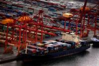 FILE PHOTO: A ship is loaded with containers at Sydney's Port Botany container terminal