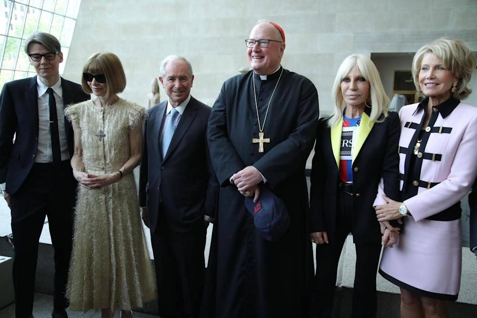 Cardinal Dolan pictured at the exhibition opening with curator Andrew Bolton, Anna Wintour, host Donatella Versace and Stephen and Christine Schwarzmann, who were honorary chairs of this year's event. (Rex Features)