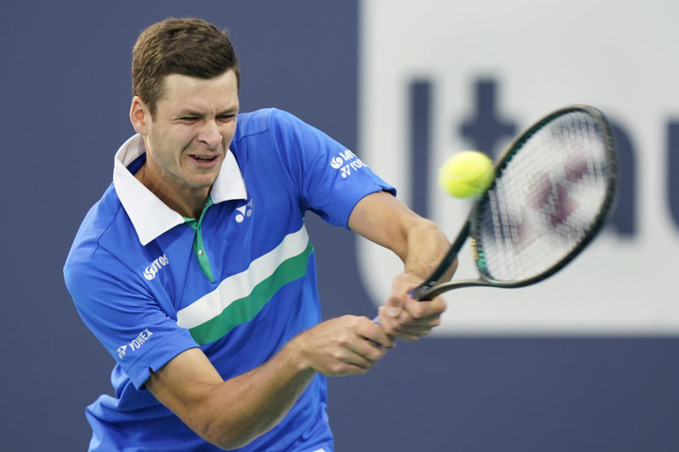 Hubert Hurkacz, of Poland, hits a backhand to Andrey Rublev, of Russia, during the Miami Open tennis tournament Friday, April 2, 2021, in Miami Gardens, Fla. (AP Photo/Wilfredo Lee)