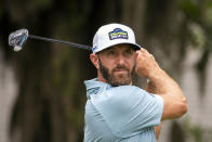 FILE - In this April 15, 2021, file photo, Dustin Johnson watches his drive off the eighth tee during the first round of the RBC Heritage golf tournament in Hilton Head Island, S.C. (AP Photo/Stephen B. Morton, File)