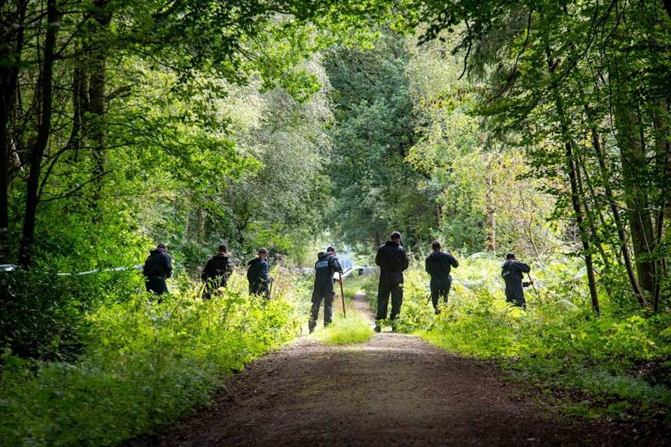 Police officers searching the land at Sand Hutton Gravel Pits near York (Mark Brickerdike/PA) (PA Wire)