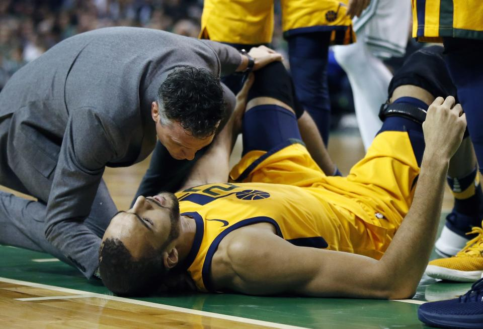 Rudy Gobert lies on the court after being injured in the first quarter against Boston on Friday night. (AP)