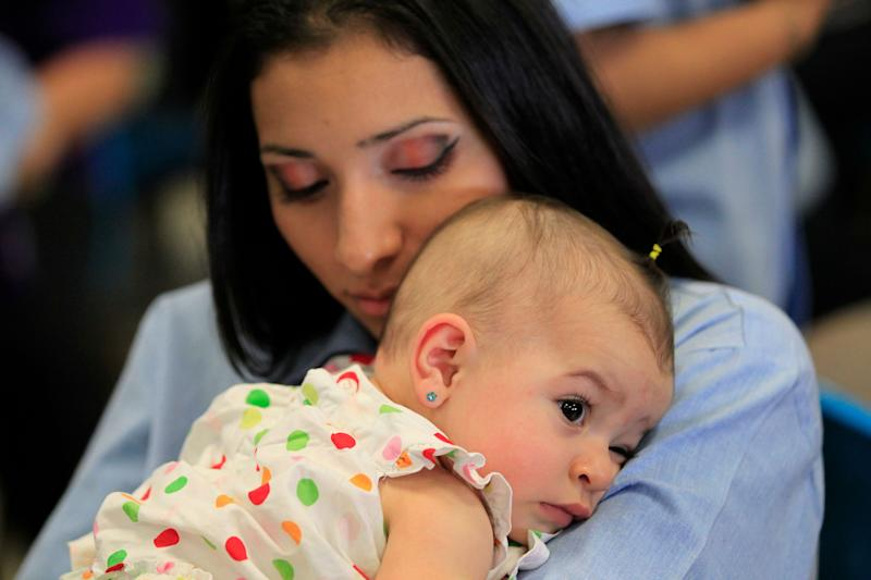 A woman hugs her baby at the California Institution for Women state prison in Chino on May 5, 2012.