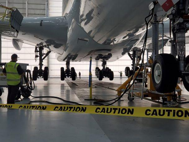 PHOTO: Checking the wheels and gears of stored aircraft after any stow-away critter have been removed at the Los Angeles Qantas facility. (Qantas)