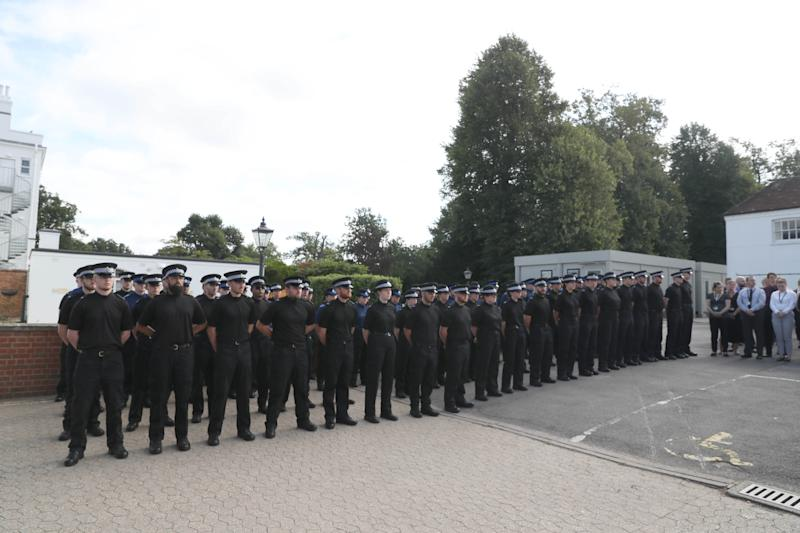 Officers lined up for a minute's silence in tribute to their colleague. (PA)