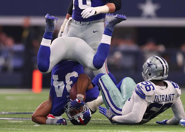 <p>Shane Vereen #34 of the New York Giants is tackled by Justin Durant #56 of the Dallas Cowboys during the fourth quarter at AT&T Stadium on September 11, 2016 in Arlington, Texas. (Photo by Tom Pennington/Getty Images) </p>