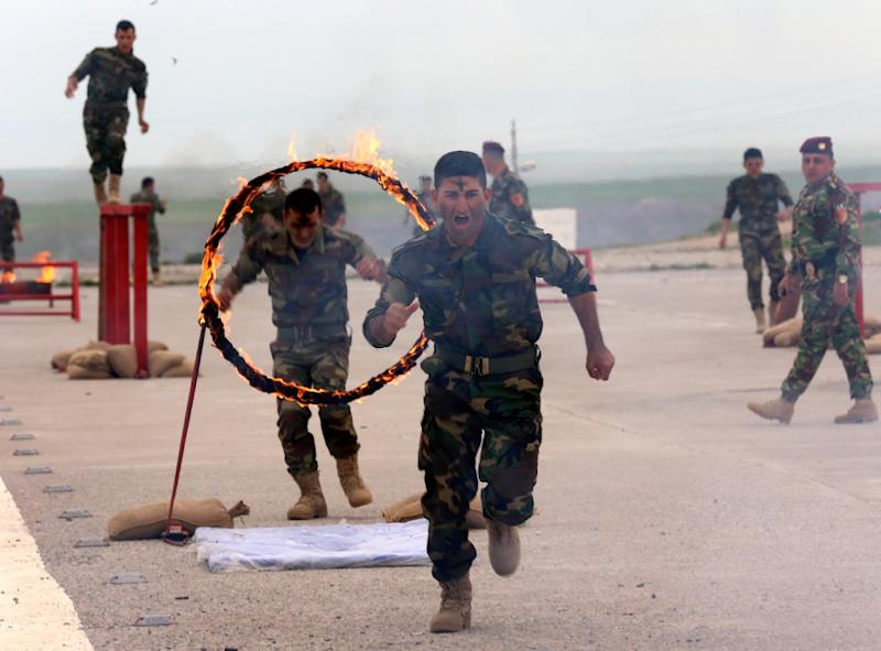 Iraqi Christian forces show their skills during their graduation ceremony in the northwestern town of Fishkhabur, near the borders with Syria and Turkey, on March 12, 2015 (AFP Photo/Safin Hamed)