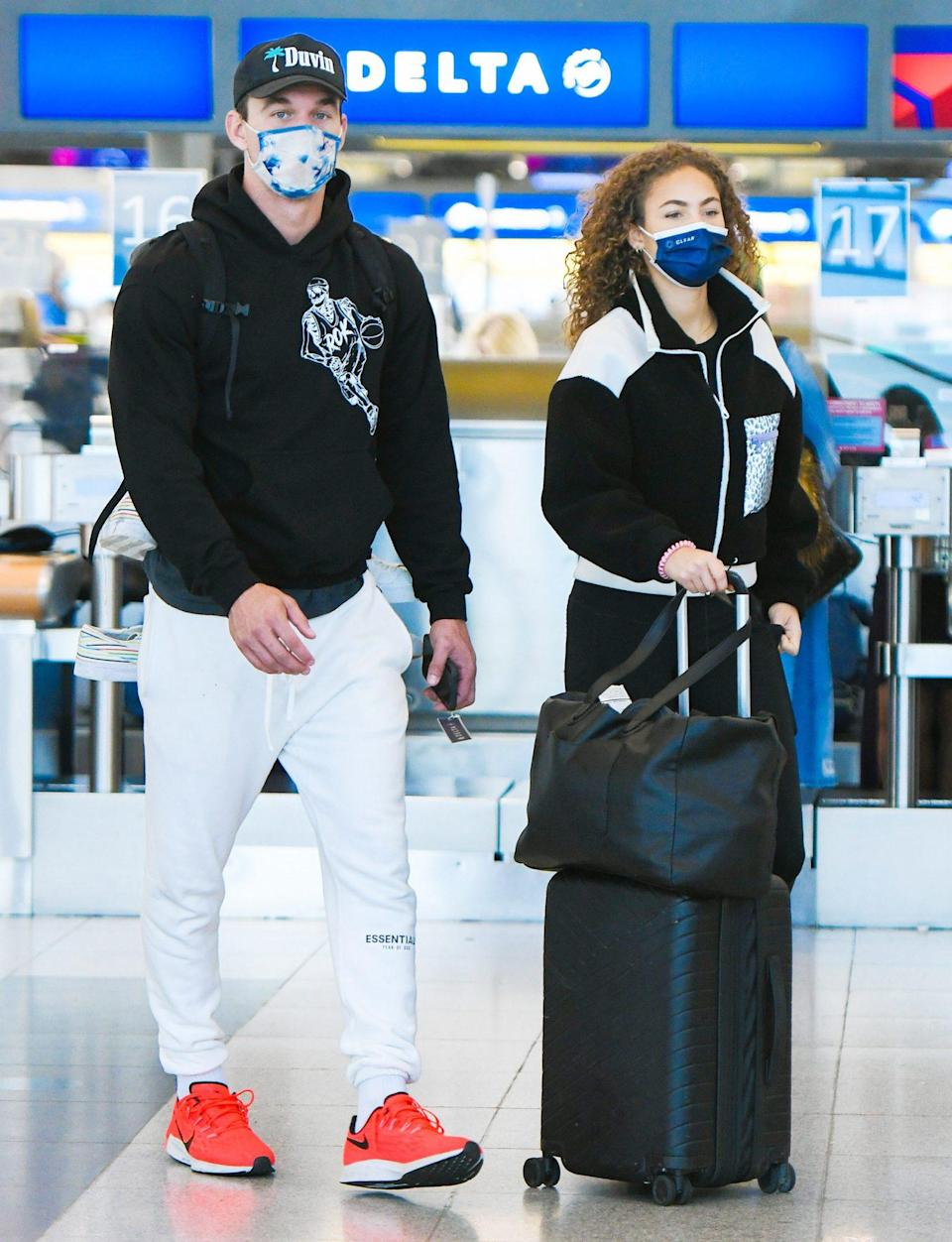 <p>Tyler Cameron and girlfriend Camila Kendra catch a flight to N.Y.C. on June 1.</p>
