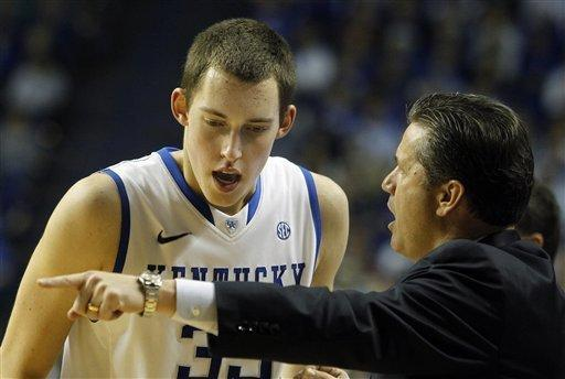 Kentucky's Kyle Wiltjer, left, receives instructions from head coach John Calipari during the second half of an NCAA college basketball game against Loyola in Lexington, Ky., Thursday, Dec. 22, 2011. Kentucky won 87-63. (AP Photo/James Crisp)