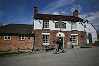 Britain was to partially lift coronavirus restrictions Monday, reopening shops, gyms, pub gardens and hairdressers