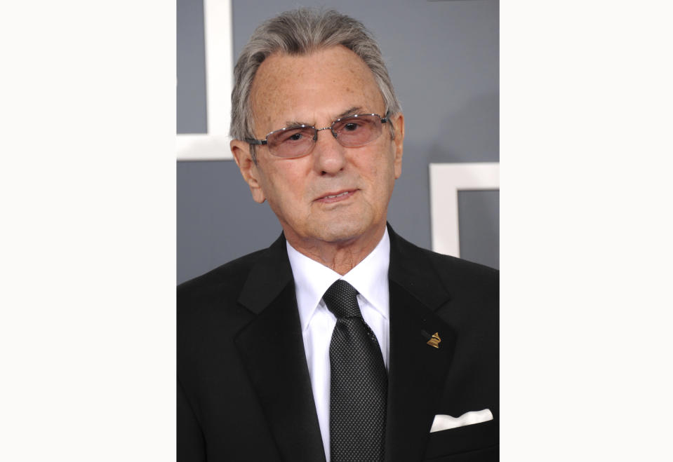 FILE - Recording engineer Al Schmitt arrives at the 55th annual Grammy Awards on Feb. 10, 2013, in Los Angeles. Schmitt, one of the world's most honored musical producers and engineers has died. The Grammy winner, who worked with everyone from Sam Cooke to Steely Dan to Frank Sinatra, was 91. (Photo by Jordan Strauss/Invision/AP, File)
