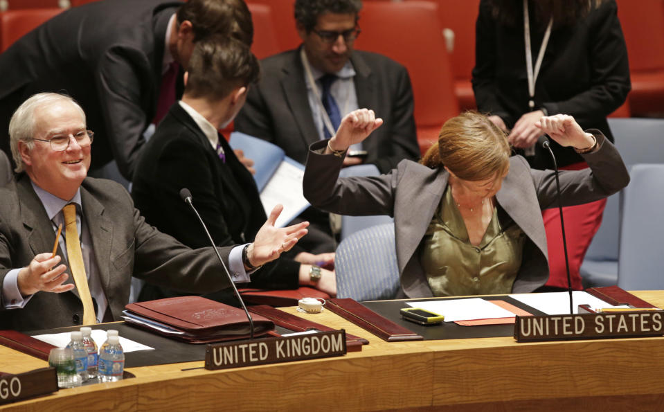 Great Britain's U.N. Ambassador Mark Lyall Grant, left, and Samantha Power, the United States U.N. Ambassador, react before a United Nations Security Council meeting at U.N. headquarters Tuesday, Dec. 24, 2013 in New York. The U.N. Security Council voted to temporarily increase the U.N. peacekeeping force in conflict-torn South Sudan to 12,500 troops from 7,000, a nearly 80 percent increase. (AP Photo/Kathy Willens)