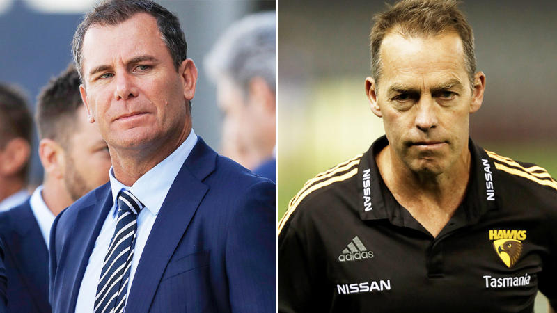 AFL great Wayne Carey (pictured left) and Hawks coach Alastair Clarkson (pictured right) after talking to the team.