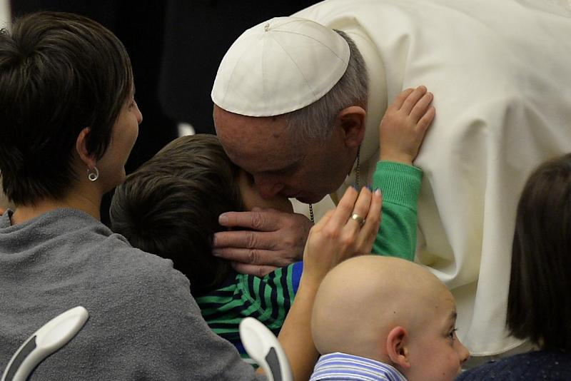 Pope Francis kisses a sick child during his weekly general audience at the Aula Paolo VI hall on January 21, 2015 at the Vatican (AFP Photo/Andreas Solaro)