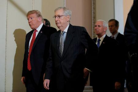 FILE PHOTO: U.S. President Donald Trump departs with U.S. Senate Majority Leader Mitch McConnell and Vice President Mike Pence after addressing a closed Senate Republican policy lunch amid a partial government shutdown on Capitol Hill in Washington, U.S., January 9, 2019. REUTERS/Jim Young/File Photo