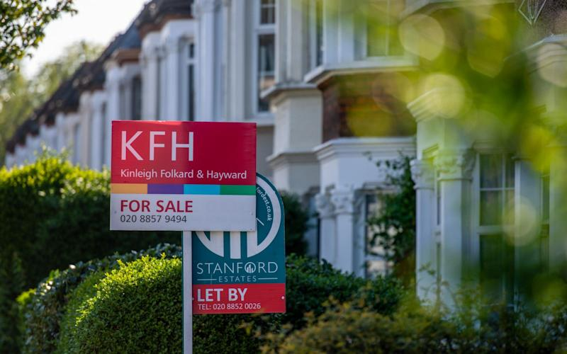 A For sale sign outside a house