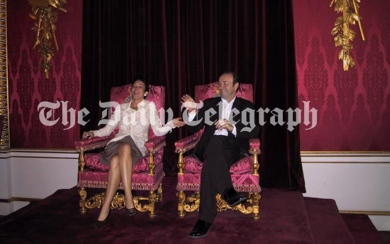 Ghislaine Maxwell and Kevin Spacey sitting on the Queen's thrones - The Telegraph