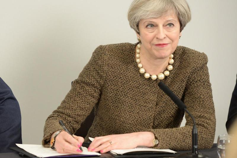Brexit start: Theresa May, seen here on Monday signing a new investment deal in Swansea, will trigger Article 50 on March 29 (Ben Birchall/PA)