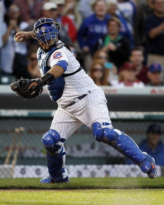 Chicago Cubs catcher Dioner Navarro throws to first base after a dropped third strike for an out against the Atlanta Braves' B.J. Upton, ending the Cub's 3-1 victory in a baseball game on Saturday, Sept. 21, 2013, in Chicago. (AP Photo/Andrew A. Nelles)