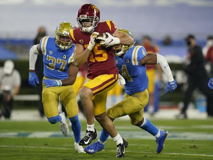 USC wide receiver Drake London runs to the end zone on a 65-yard touchdown against UCLA on Dec. 12, 2020.