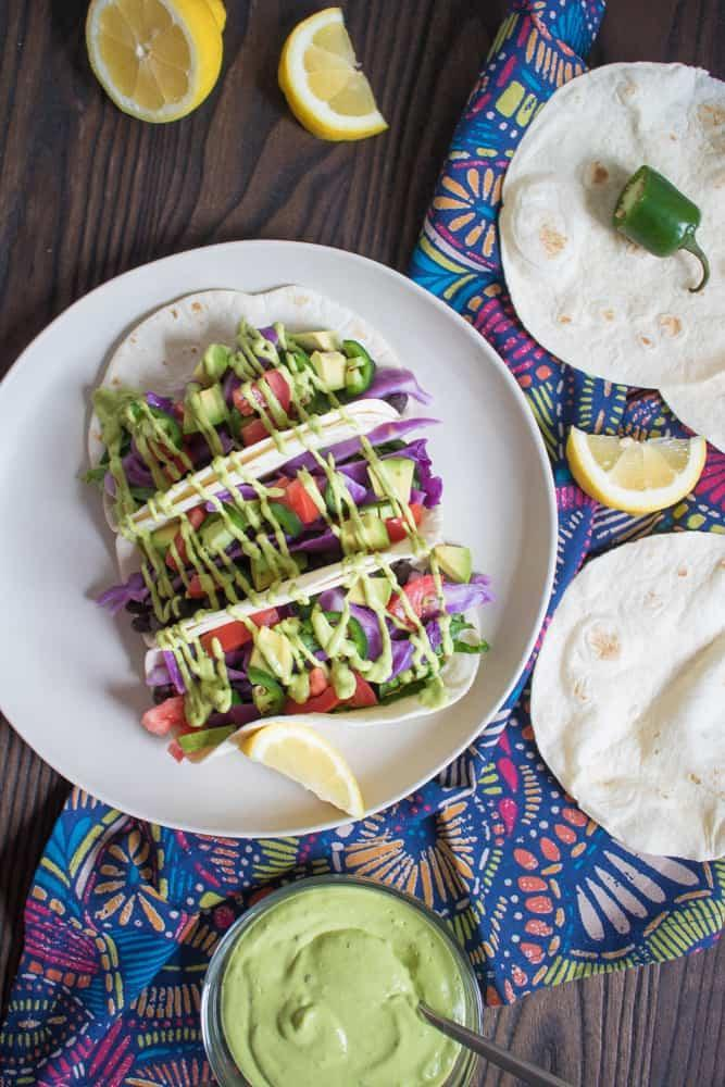 """<p>The creamy, herby, slightly sweet sauce drizzled on top of these tacos makes standard black beans taste like something exciting and new.</p> <p>Get the recipe <a href=""""https://www.orchidsandsweettea.com/vegan-black-bean-tacos-avocado-basil-mango-sauce/"""" rel=""""nofollow noopener"""" target=""""_blank"""" data-ylk=""""slk:here"""" class=""""link rapid-noclick-resp"""">here</a>.</p>"""