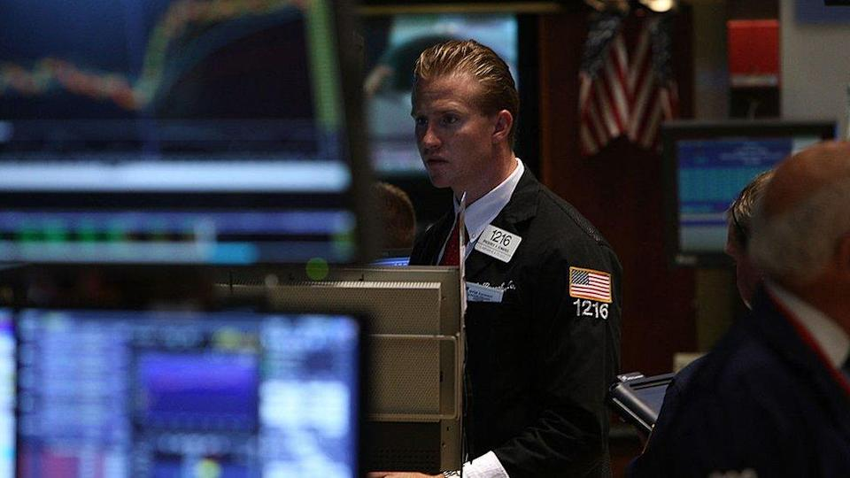 A trader works on the floor of the New York Stock Exchange on July 23, 2009 in New York, New York