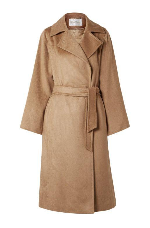 """<p><a class=""""link rapid-noclick-resp"""" href=""""https://www.net-a-porter.com/en-gb/shop/product/max-mara/manuela-icon-belted-camel-hair-coat/1175276"""" rel=""""nofollow noopener"""" target=""""_blank"""" data-ylk=""""slk:SHOP NOW"""">SHOP NOW</a></p><p>The queen of the camel coat, Max Mara ups its game every season with a new take on the classic – but never strays too far from the signatures we know and love. Made entirely from camel hair brushed to create a sateen finish, this Manuela version has a simple wrap shape and self-tying belt, but the kimono sleeves are a modern update.</p><p>Manuela Icon Belted Camel Hair Coat, £1,585, Max Mara</p>"""