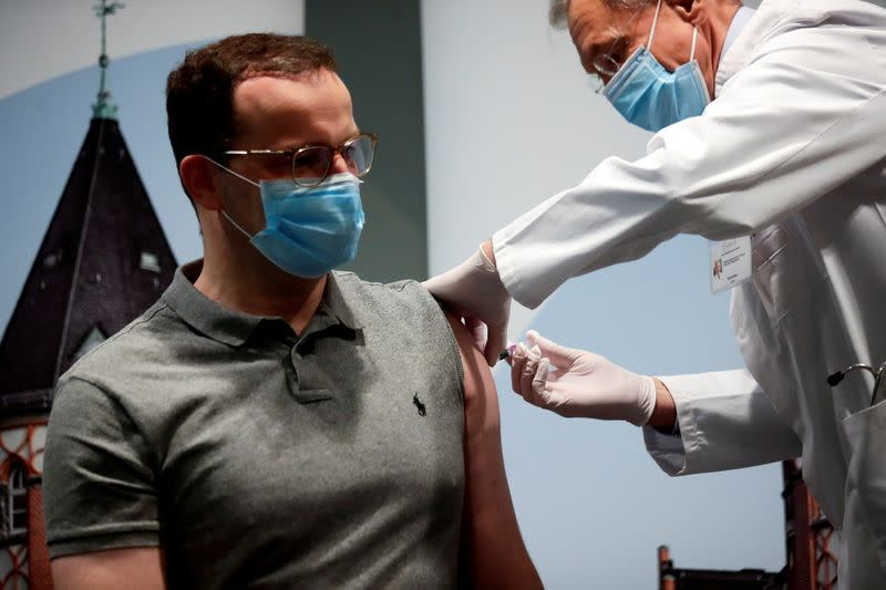 FILE PHOTO: German Health Minister Spahn receives an influenza injection at Charite in Berlin