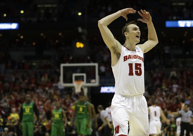 Wisconsin forward Sam Dekker (15) celebrates during the second half of a third-round game against the Oregon in the NCAA college basketball tournament Saturday, March 22, 2014, in Milwaukee. Wisconsin won 82-77. (AP Photo/Morry Gash)