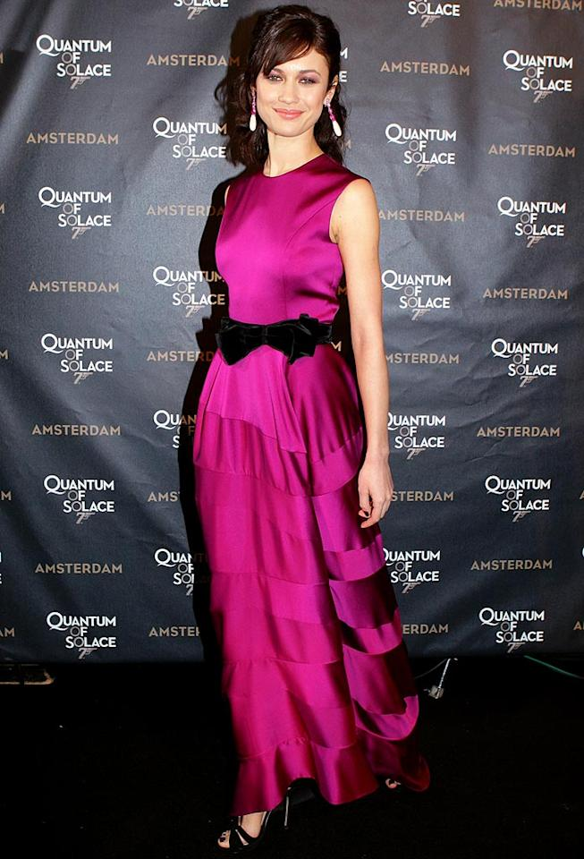 """James Bond's new babe Olga Kurylenko knocked 'em dead in a YSL fuchsia silk frock and teardrops earrings at the """"Quantum of Solace"""" premiere in Amsterdam. Greetsia Tent/<a href=""""http://www.gettyimages.com/"""" target=""""new"""">GettyImages.com</a> - November 4, 2008"""