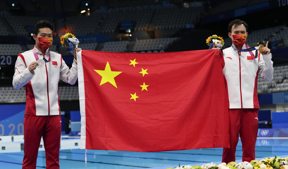 Wang Zongyuan of China, left, silver medal and Xie Siyi of China gold medal pose for a photo after men's diving 3m springboard final at the Tokyo Aquatics Centre at the 2020 Summer Olympics, Tuesday, Aug. 3, 2021, in Tokyo, Japan. (AP Photo/Dmitri Lovetsky)