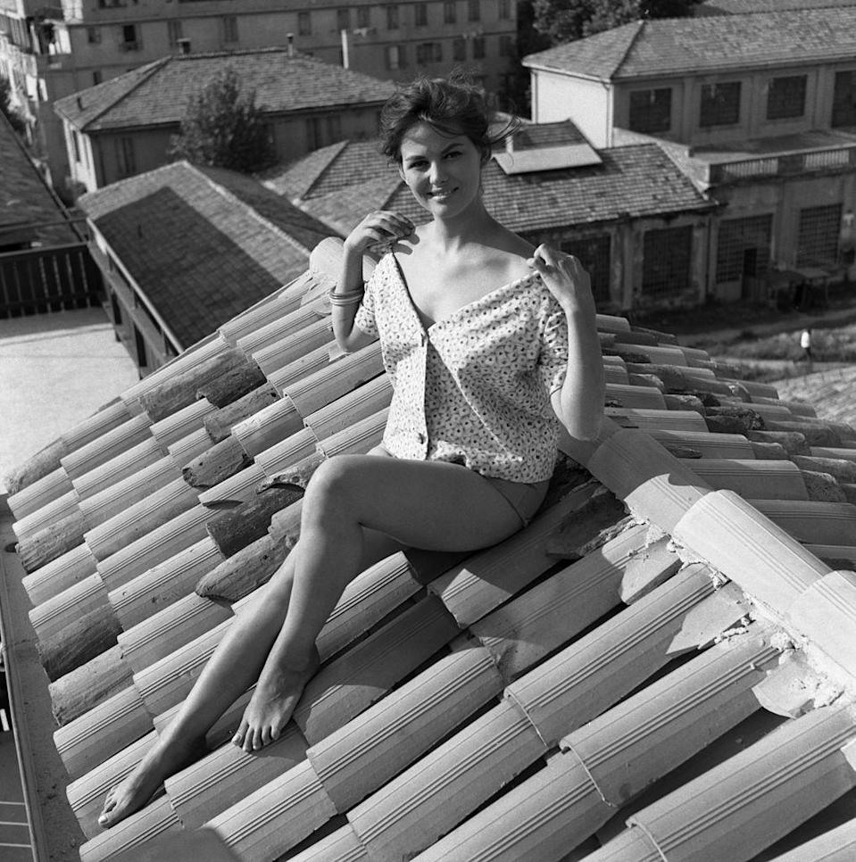 <p>Italian actress Claudia Cardinale sitting on the rooftop in Rome, Italy. </p><p>Other celebrity visitors this year: actress Greta Garbo, actor Gerard Herter, Swedish actress Anita Ekberg.</p>