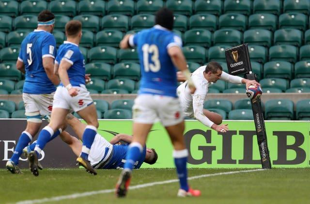 England's Jonny May takes to the air before touching down against Italy