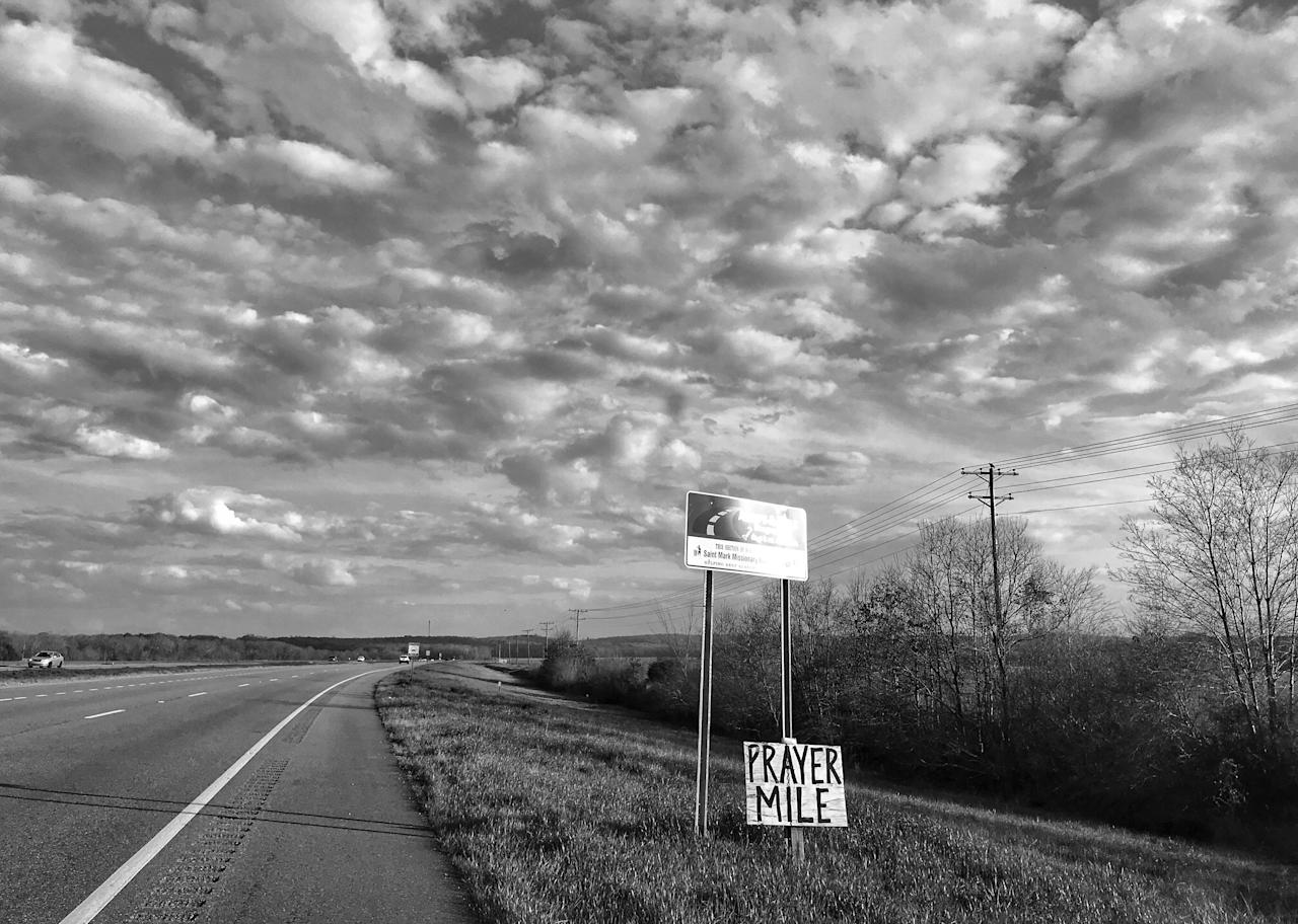 "<p>A sign advertising ""prayer mile"" on Highway 80 outside Selma, Ala., the route taken by participants in the 1965 Selma to Montgomery freedom march. (Photo: Holly Bailey/Yahoo News) </p>"