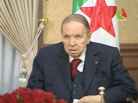 Algeria's President Abdelaziz Bouteflika looks on during a meeting with army Chief of Staff Lieutenant General Gaid Salah in Algiers, Algeria, in this handout still image taken from a TV footage released on March 11, 2019.  Algerian TV /Handout via Reuters