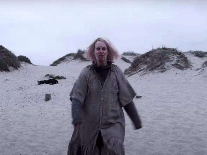 """Sarah Paulson walks on the beach in the trailer for """"American Horror Story: Double Feature."""""""