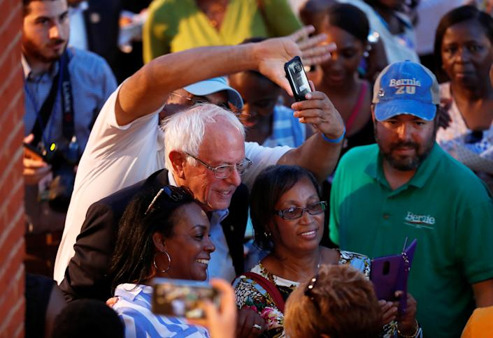"""Democratic presidential candidate Bernie Sanders mingles with the crowd during """"Jim Clyburn's World Famous Fish Fry"""" in Columbia, South Carolina, U.S., June 21, 2019.  REUTERS/Randall Hill"""