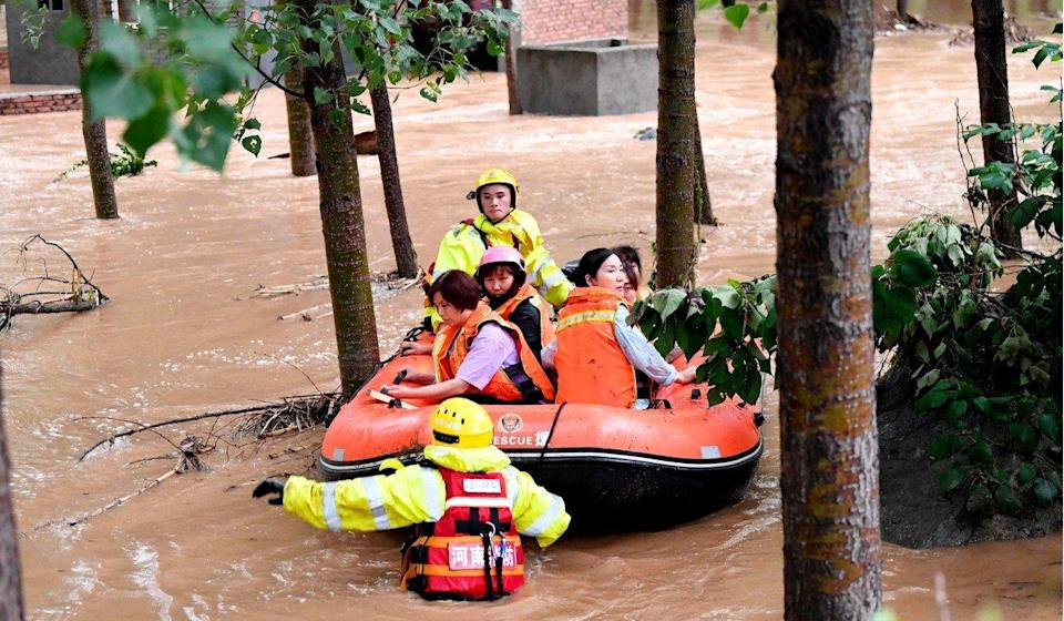 Rescuers transfer stranded villagers in Henan province. Photo: Xinhua