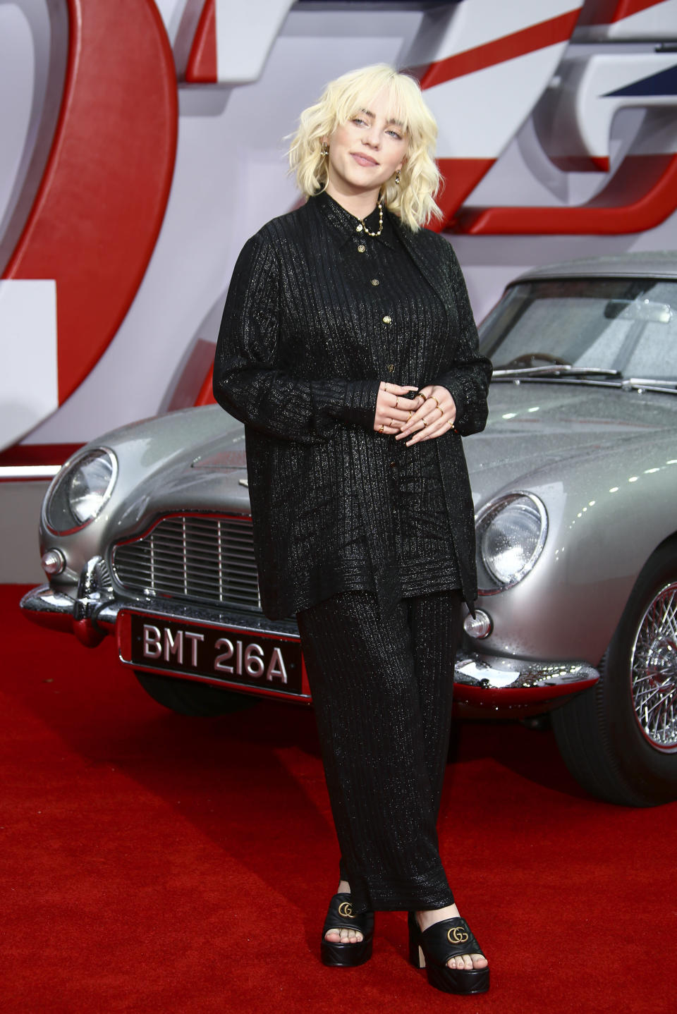 Billie Eilish poses for photographers upon arrival for the World premiere of the new film from the James Bond franchise 'No Time To Die', in London Tuesday, Sept. 28, 2021. (Photo by Joel C Ryan/Invision/AP)